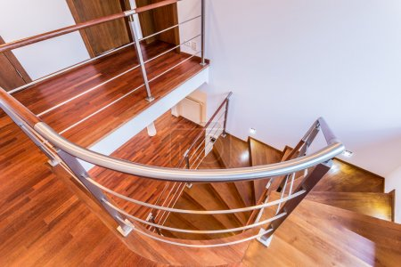 Photo for Close-up of spiral wooden stairs in luxury apartment - Royalty Free Image