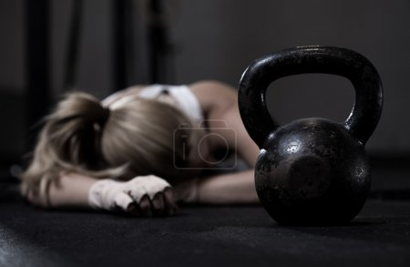 Photo for Portrait of drained girl after hard crossfit training - Royalty Free Image