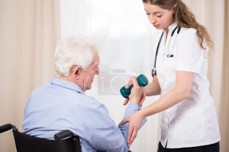 Practitioner showing patient exercise