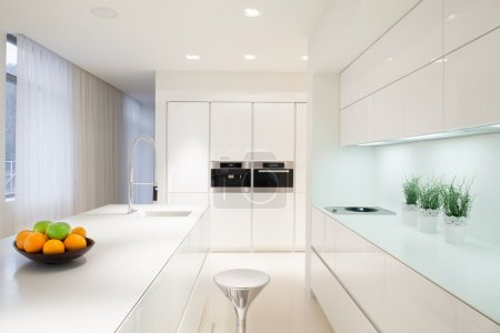 Photo for Horizontal view of exclusive white kitchen interior - Royalty Free Image