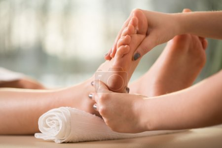 Photo for Close-up of female hands doing foot massage - Royalty Free Image