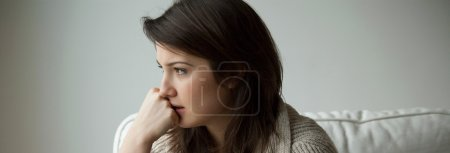 Photo for Sad depressed young woman thinking about her life - Royalty Free Image