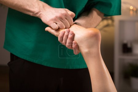 Photo for Close-up of male hands doing foot massage - Royalty Free Image