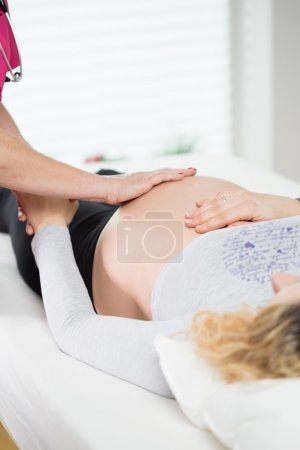 Photo for View of pregnant woman during medical appointment - Royalty Free Image