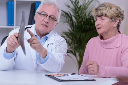 Doctor with patient in office
