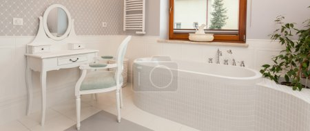 Photo for White spacious bathroom with a dressing table, panorama - Royalty Free Image