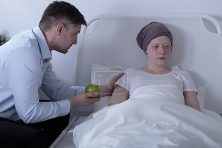 Dad caring about ill daughter