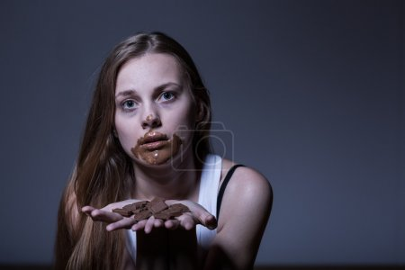 Photo for Girl with eating disorder during bulimic attack - Royalty Free Image