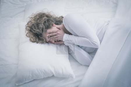 Photo for Picture of depressed woman sleeping all day - Royalty Free Image