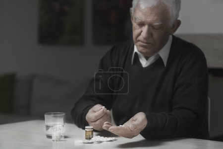 Man Taking a lot of medicines