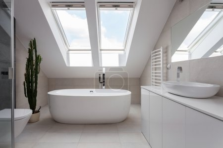 Freestanding bath in white bathroom
