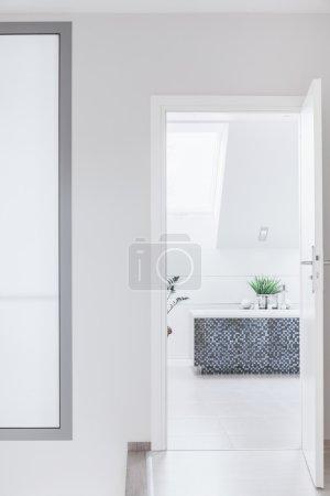 Luxurious white attic bathroom