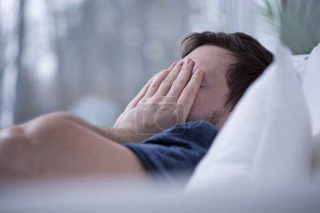 Man having some sleeping disorders like insomnia...