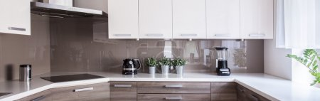 Photo for Picture of beige and white kitchen design - Royalty Free Image
