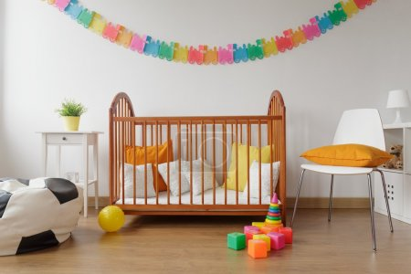 Newborn bedroom with wooden crib