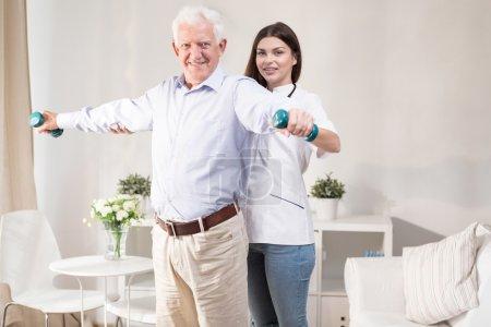 Senior man training with dumbbells