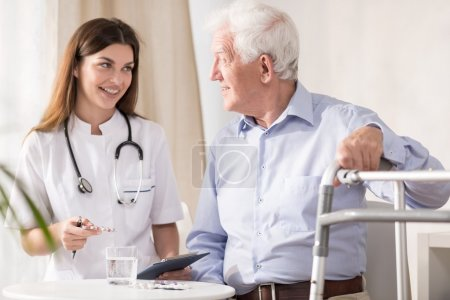 Doctor visiting patient at home