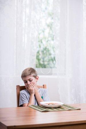 Boy refusing to eat