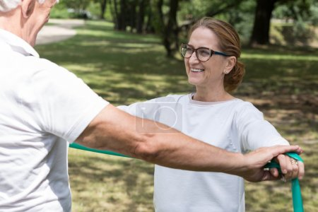 Elderly pair workout with band