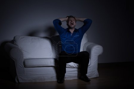 Man mourning after wife's death