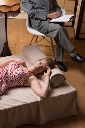 Emotionally unstable woman receiving psychotherapy