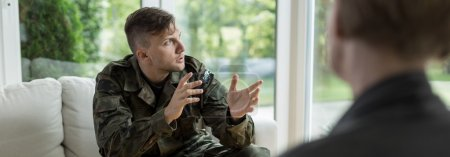 Photo for Soldier talking about war to his psychotherapist - Royalty Free Image
