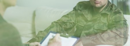 Photo for Interview with soldier in green military uniform - Royalty Free Image