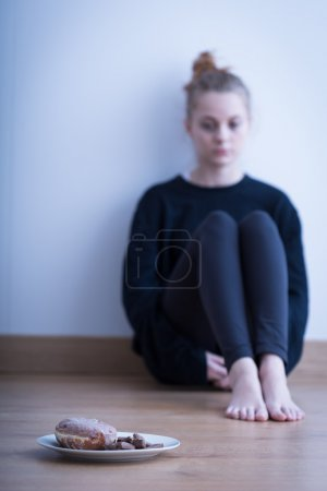 Photo for Picture of a girl with fear of gaining weight - Royalty Free Image