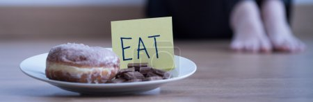 Photo for Conceptual image presenting problem of eating disorder - Royalty Free Image