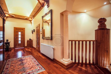 Spacious hallway with wooden floor