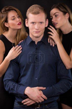 Seductive women tempting handsome man