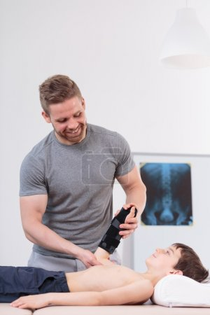 Smiling physical therapist