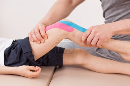 Small boy with kinesio tape