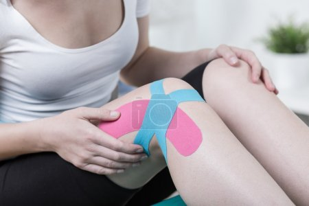 Kinesio tape applied to patients leg