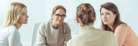 Photo for Panorama of female psychologist helping her stressed and depressed patients - Royalty Free Image