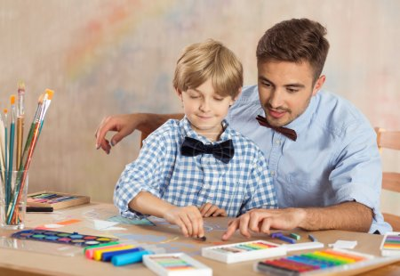 Nursery teacher and little child drawing picture...