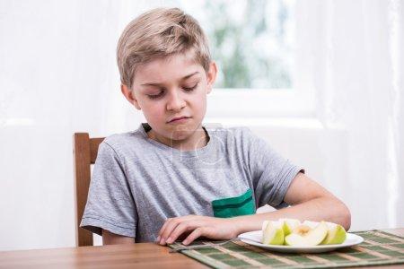 Boy doesn't like fruit