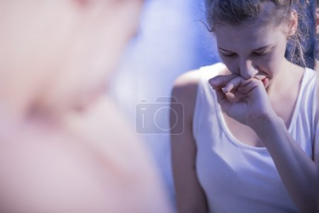 Photo for Reflection in mirror of teenage girl feeling sick - Royalty Free Image