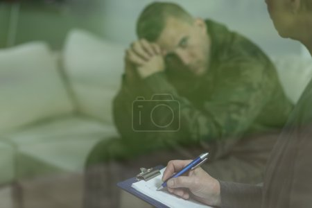 Photo for Photo of young soldier with mental health problem - Royalty Free Image