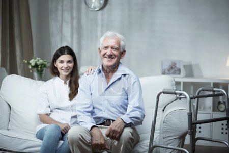 Photo for Elderly man with a community nurse visiting him - Royalty Free Image