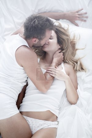 Passionate foreplay in bed