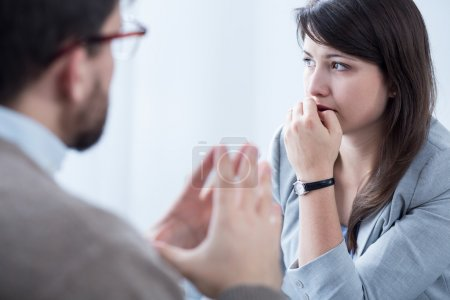 Photo for Image of stressed woman during meeting wuth personal coach - Royalty Free Image