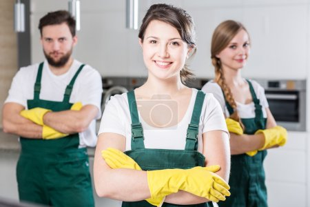 Photo for Professional cleaning team in uniforms and yellow rubber gloves - Royalty Free Image
