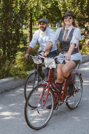 Toronto, Canada - September 20, 2014: Unidentified participants of Tweed Ride Toronto in vintage style clothes riding on their bicycles. This event is dedicated to the style of old England.