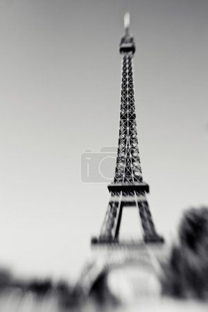 Blurred shot of the Eiffel Tower in Paris, France, selective focus on details. Lensbaby photo of Eiffel Tower, black and white colors