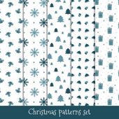 Set of simple retro Christmas patterns Winter background Endless textures in blue colors