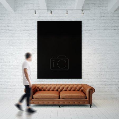 man walking  in gallery