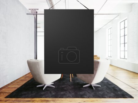 Photo empty black canvas hanging in center of meeting room. Interior modern loft building. Wood floor, table, furniture,concrete wall,big windows. Horizontal, blank mockup. 3d rendering