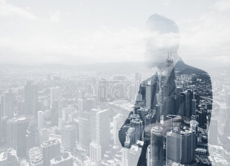Photo of stylish adult businessman wearing trendy suit. Double exposure, panoramic view contemporary city background. Horizontal