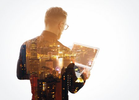 Photo for Double exposure  young bearded businessman wearing black shirt and holding contemporary notebook hands. Isolated white, night city background. - Royalty Free Image